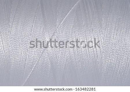 Spool of thread macro background   - stock photo