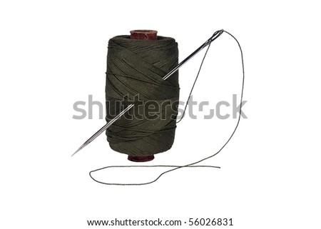 Spool of thread. Needle isolated on white with clipping path - stock photo