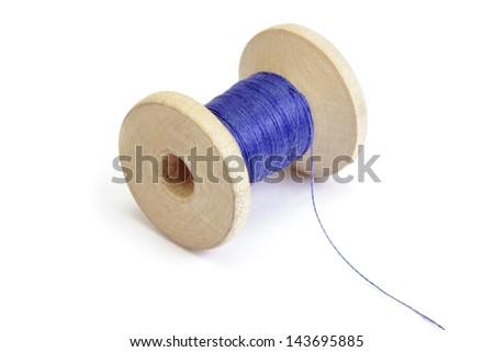 Spool of thread on white background - stock photo