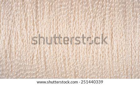 Spool of white thread macro background  - stock photo