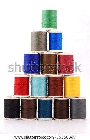 Spools of colours threads isolated on white - stock photo