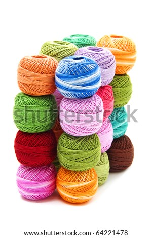 spools of many colors on a white background - stock photo