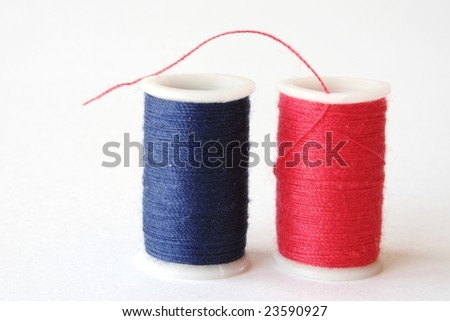 Spools of Red and Blue Thread