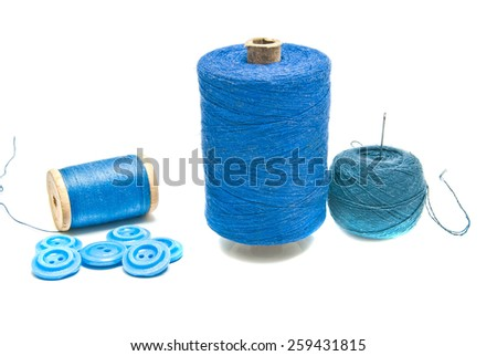 spools of thread and ball of yarn on white  - stock photo
