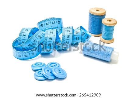 spools of thread, buttons and meter closeup on white background  - stock photo