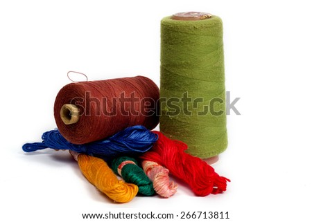 Spools of threads on white background - stock photo