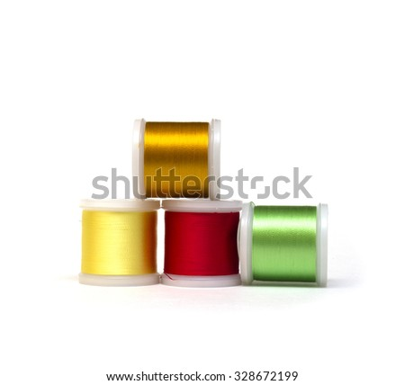 Spools with color threads for embroidery  - stock photo