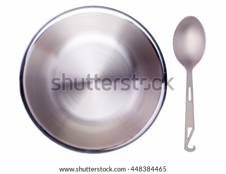 Spoon and a bowl isolated on a white background