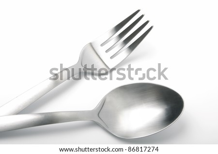 Spoon and fork isolated on white background