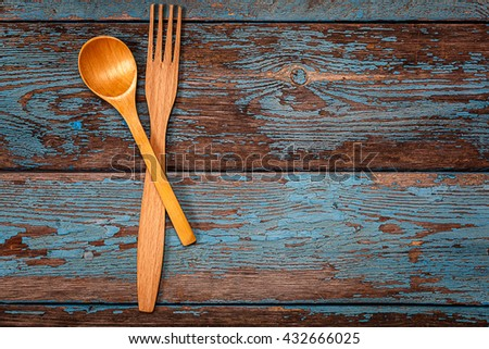 Spoon and fork. Set kitchen utensils on a wooden background. Accessories for cooking. - stock photo