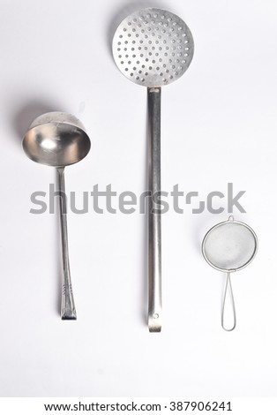 Spoon and Strainer - stock photo