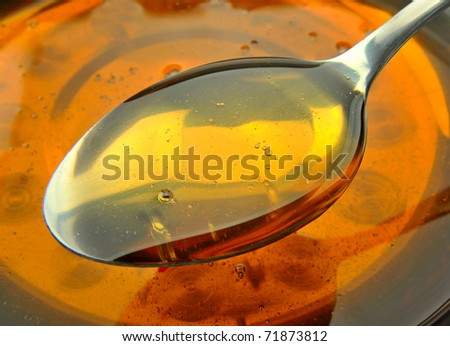 Spoon filled with oil - stock photo