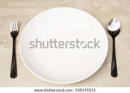 spoon, fork and empty dish on a tile surface - Empty Dish  (ready for your design)