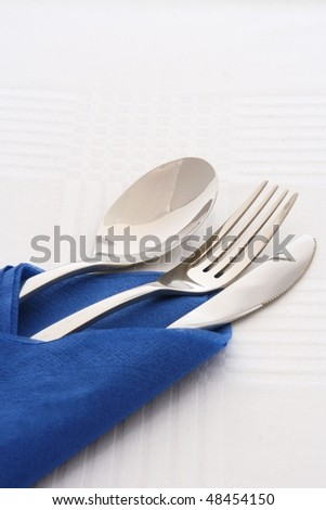 Spoon fork and knife in blue napkins