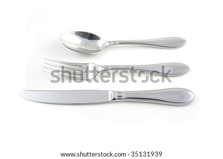 spoon, fork and knife isolated on white - stock photo