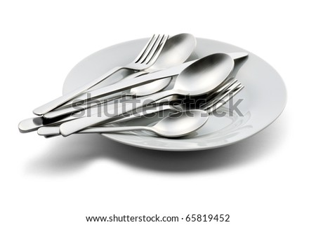 Spoon,fork,and knife on white plate