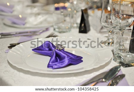 Spoon, fork , clean plates ,glasses and a knife tied up celebratory ribbon. Lie on table - stock photo