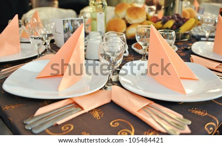 Spoon,forks,knife, clean plates ,glasses tied up celebratory ribbon - stock photo