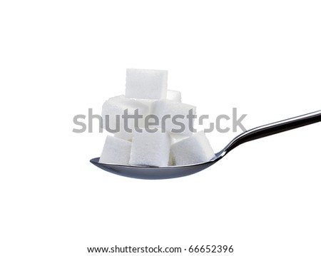 spoon full of white refined sugar cubes or lumps isolated on a white background - stock photo