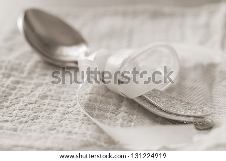 spoon lying on a towel - stock photo