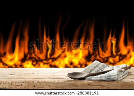 spoon napkin desk and fire place  - stock photo