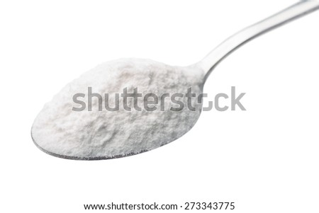 Spoon of baking soda isolated on white - stock photo