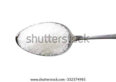 Spoon of fine granulated sugar - stock photo