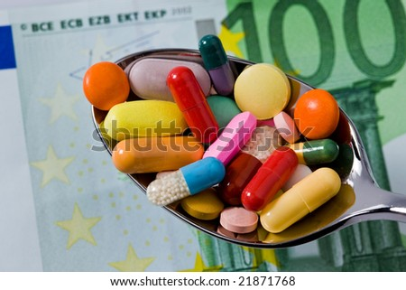 Spoon on a lie tablets - stock photo
