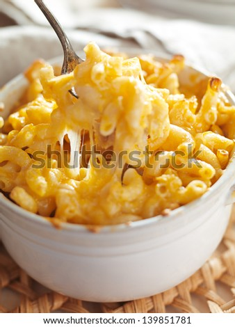 spoon picking up macaroni and cheese - stock photo