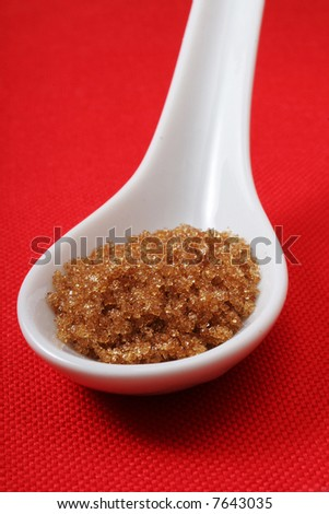 Spoon white with brown sugar - stock photo