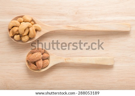 Spoon with cashew nuts and almonds - stock photo