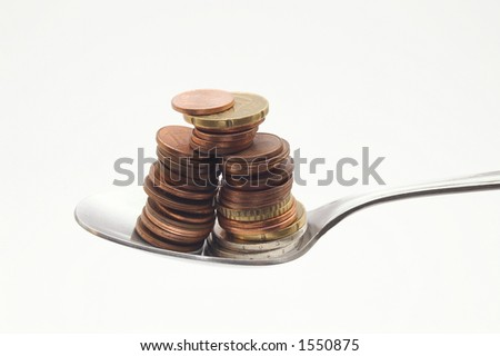 spoon with coins - stock photo