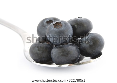Spoon with fresh blueberries isolated on white background with shadow. - stock photo