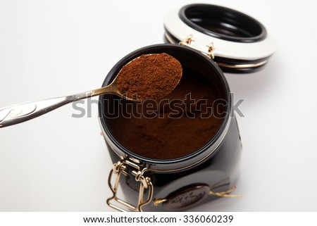 spoon with ground coffee