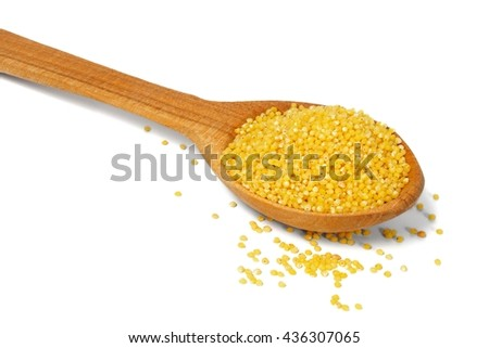 Spoon with millet on white background