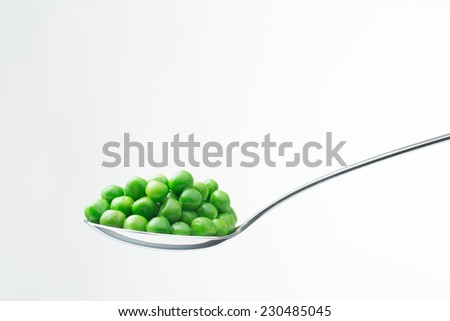 spoon with peas isolated on white background - stock photo