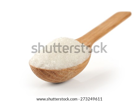 Spoon with sugar on a white background. Macro. - stock photo