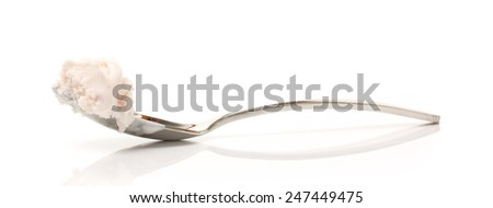 Spoon  With Vanilla Soft Ice Cream On White Background - stock photo