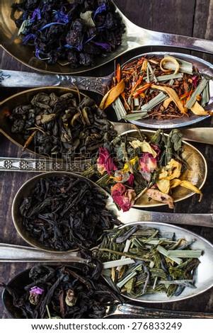 spoon with various tea - stock photo
