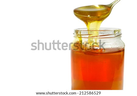 Spooned from a jar of honey - stock photo