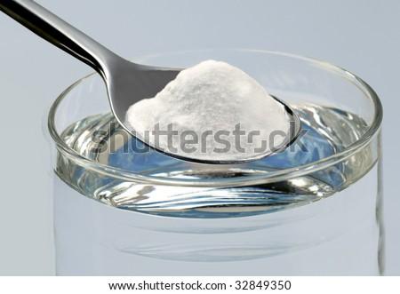 Spoonful of baking soda - stock photo