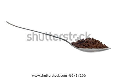 Spoonful of instant coffee granules, isolated over white background - stock photo