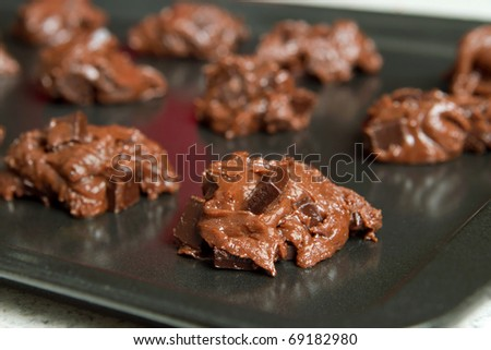 spoonfuls of double chocolate cookie batter on a tray - stock photo