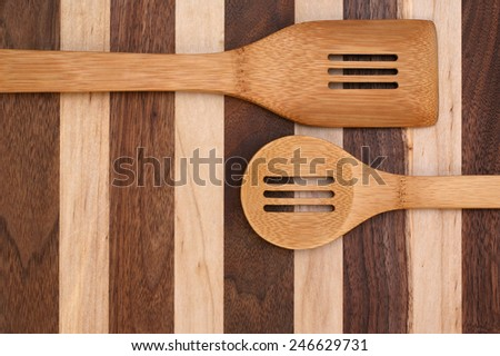 Spoons on rustic cutting board with copy space  - stock photo