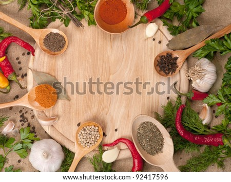 spoons with spices on wooden board background - stock photo