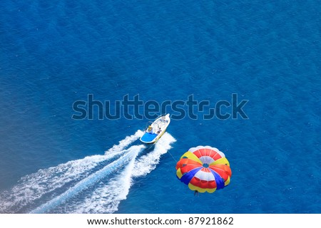 Sport activity - para sailing over the sea view from above - stock photo