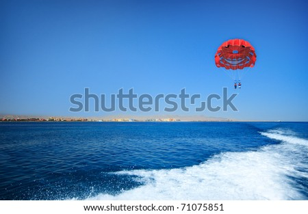 Sport activity - Parasailing over the Mediterranean sea - stock photo