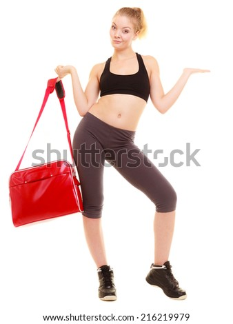 Sport and active lifestyle. Full length of fitness sporty girl with gym bag showing blank copy space on hand isolated on white.