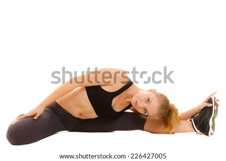 Sport and active lifestyle. Sporty flexible girl fitness woman in sportswear doing stretching exercise isolated on white.