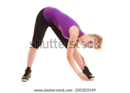 Sport and active lifestyle. Sporty flexible girl fitness young woman in sportswear doing stretching exercise isolated on white.